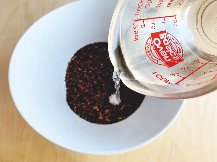 pouring hot water on tea mix