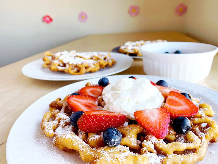 funnel cakes on plates